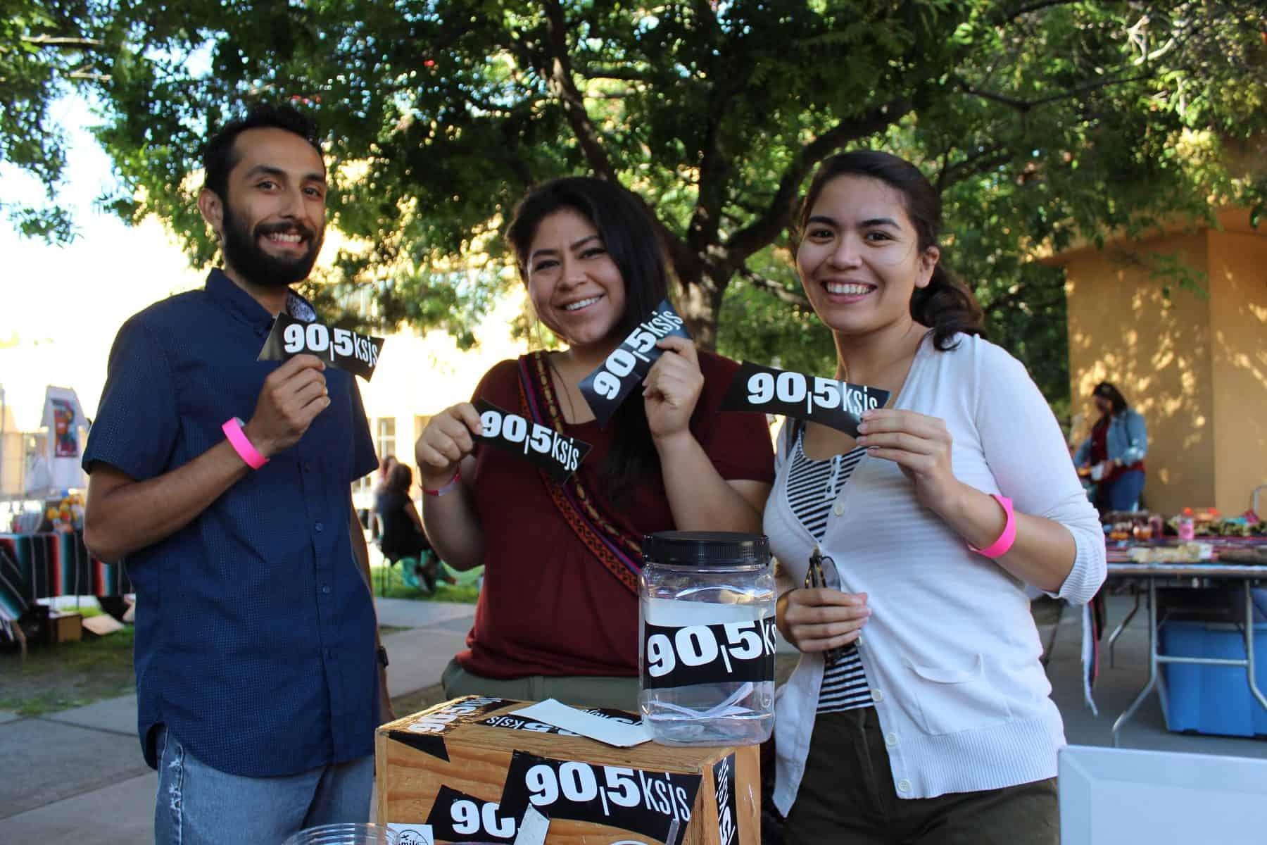 Three Community Members Holding Ksjs Stickers