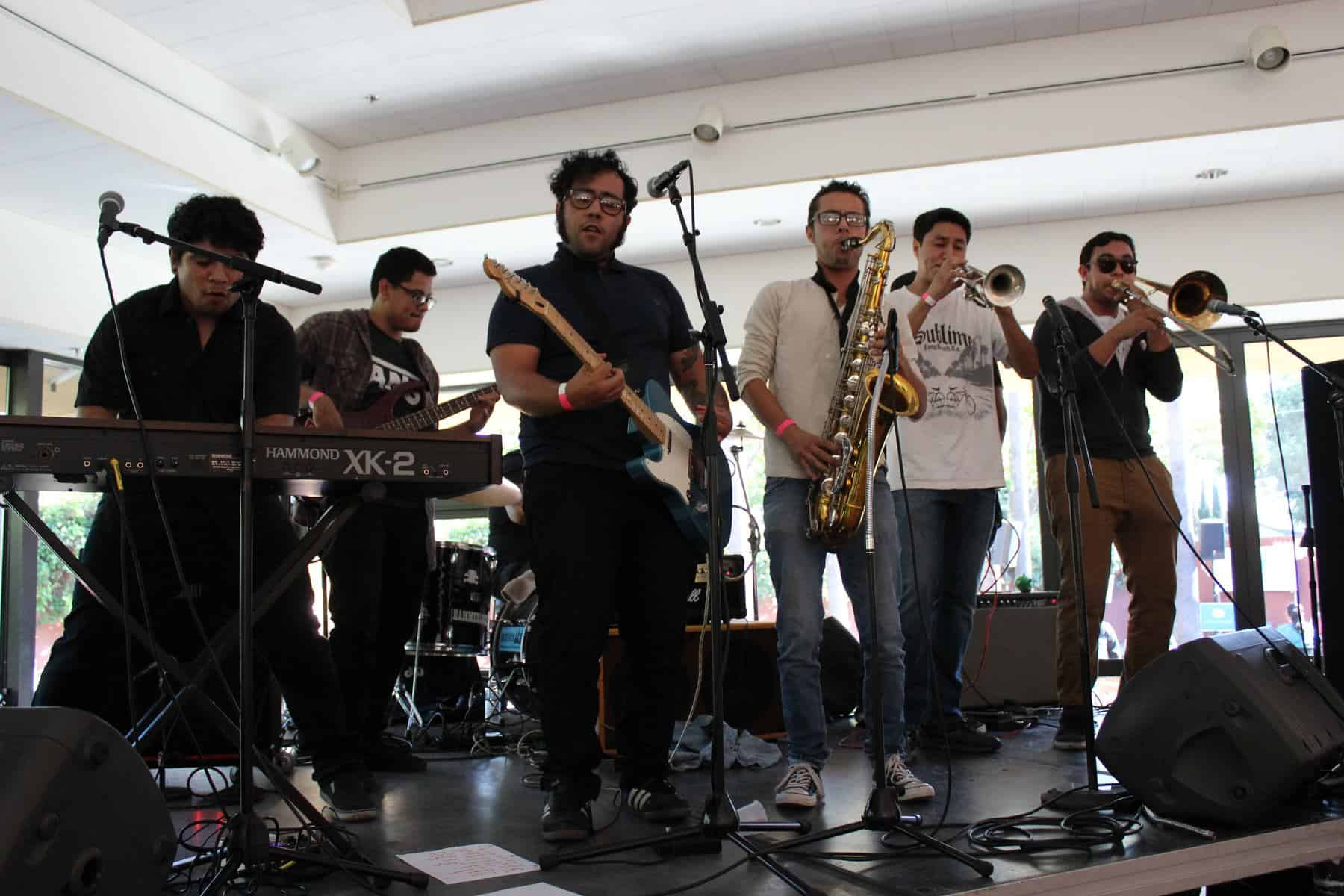 Six Member Band With Horns Performing