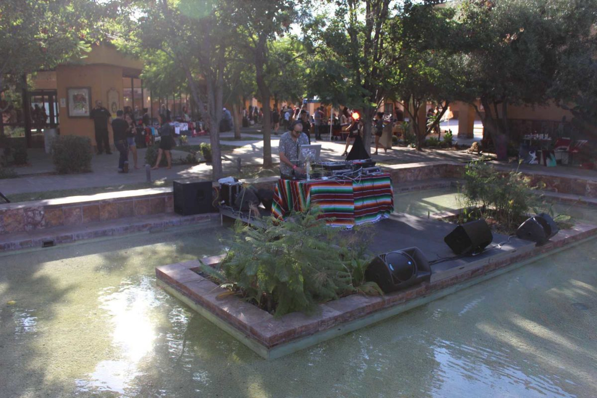 DJ across pond of water