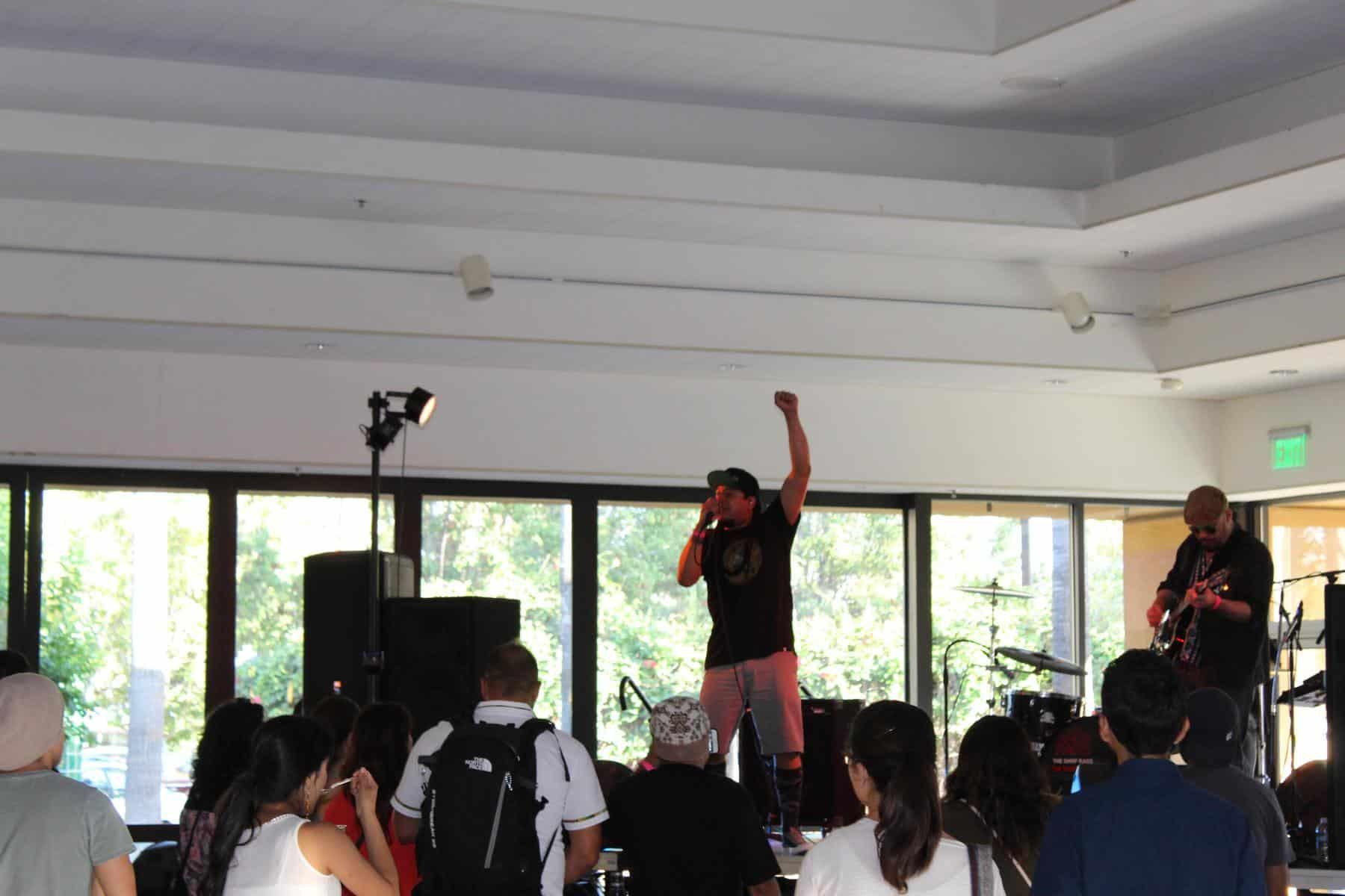 Vocalist raising fist in the air