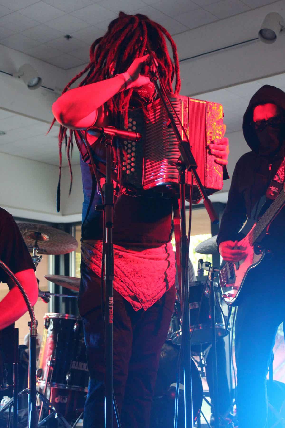Medium shot of accordionist on stage