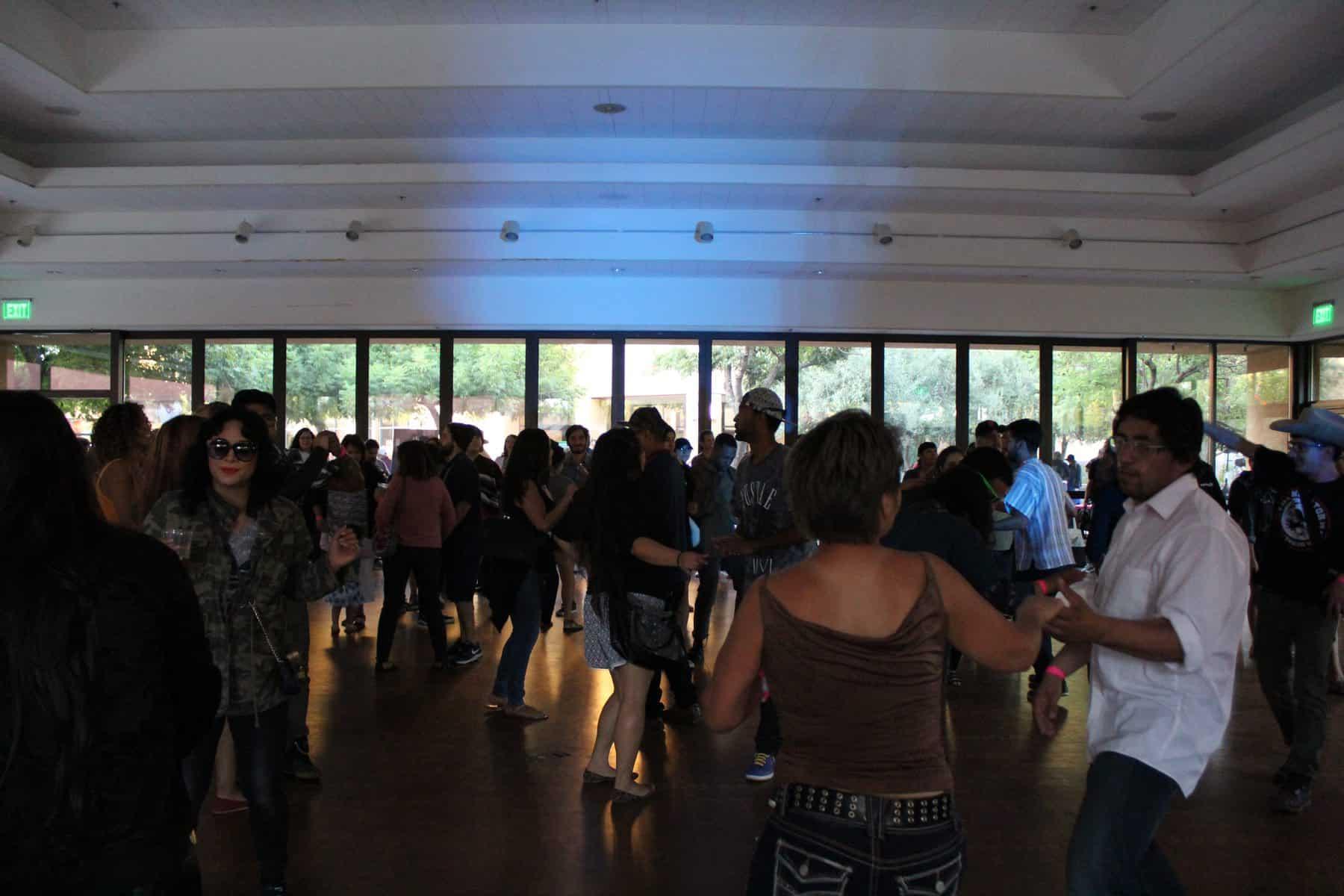 Crowded Room Of Audience Members Dancing