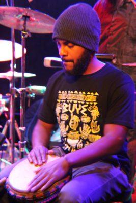 Man Playing Bongo Drum