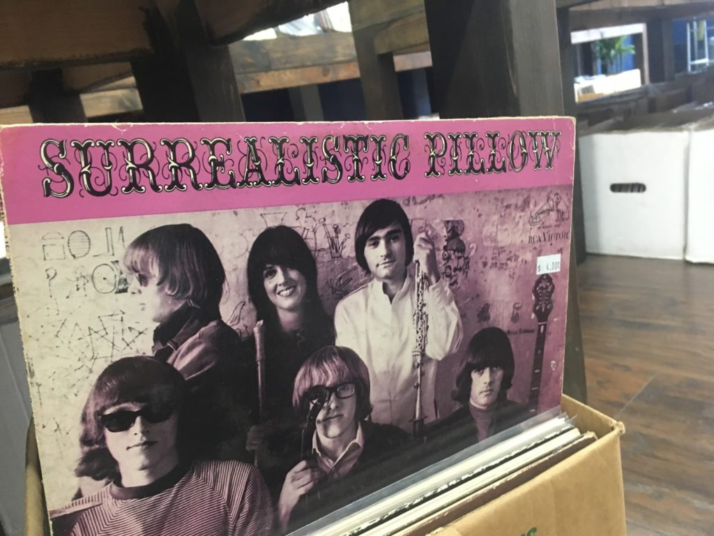"Old box holding vinyl records and pink ""Surrealistic Pillow"" record"